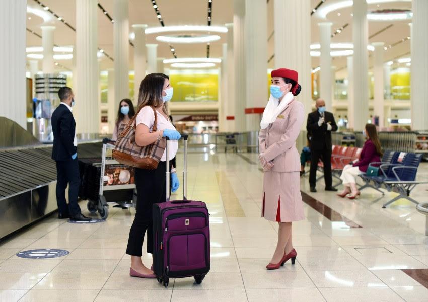 Emirates dekt passagiers tegen Covid-19 kosten